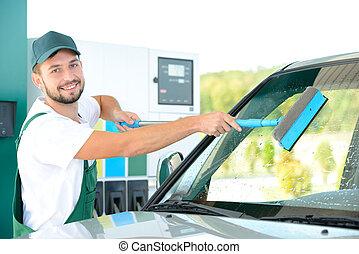 Petrol filling station - Washing car window while filling...