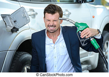 Petrol filling station - Emotional businessman shooting...
