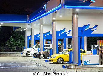 Petrol gas station in blue at night with lights