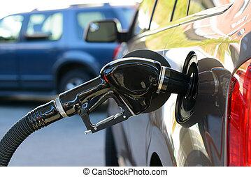 Petrol pump filling - Close up of gas filling at petrol...
