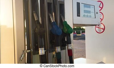 Petrol pump filling. Fuel oil dispenser. Detail of petrol...