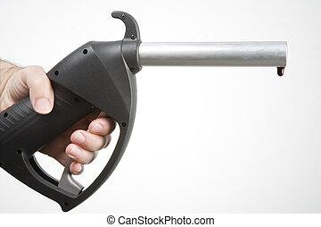 petrol pump - man\\\'s hand holding a petrol pump with a...