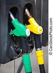 Petrol pumps - Petrol pump nozzles in a service station