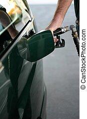 Petrol Refueling - Man refueling car at petrol station
