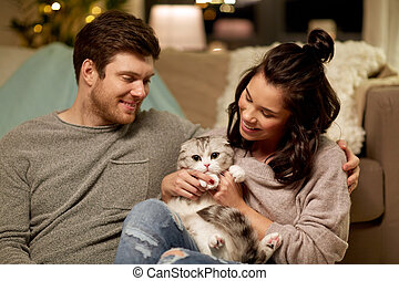 happy couple with cat at home