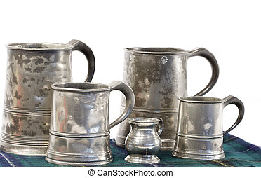 Pewter drinking mugs with measure - Old pewter ale jars of...