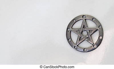 Pewter pentacle on white background