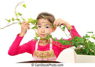 pflanze, lächelnden mädchen, asiatisch