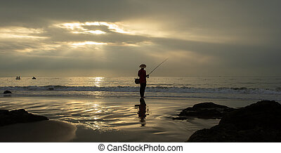PHAN THIET, VIETNAM: Lonely fishman at the beach at sunrise