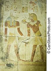 Pharaoh Seti offering to Anubis