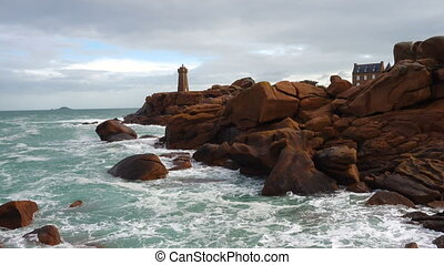 Phare de Men Ruz lighthouse at the Rose Granit Beach,...