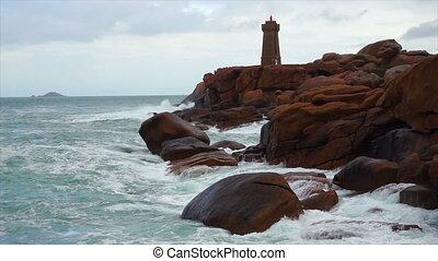 Phare de Men Ruz lighthouse at the Rose Granit Beach,...