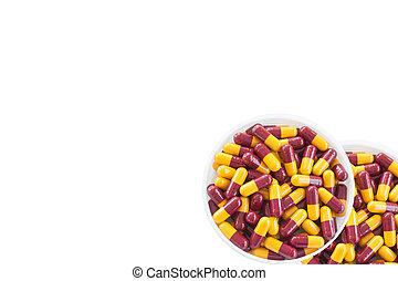 Pharmaceutical capsules on a white