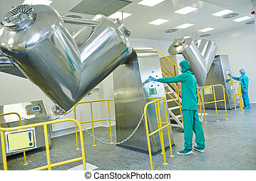 pharmaceutical factory workers operating powder mixer...