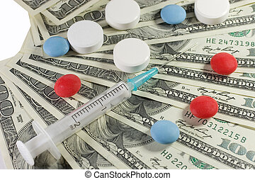 Pharmaceutical industry - Closeup of a syringe and pills on...