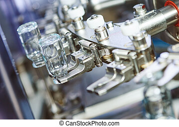 pharmaceutical industry. medicine glassware bottles washing in cleaning machine