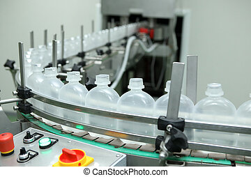 pharmaceutical industry, medicine pills are filling in the plastic bottle on production line machine conveyor at the medical factory. Ampoule filling and sealing machine, equipment in pharmaceutical.
