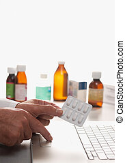 Pharmacist and laptop computer - Pharmacist holding ...