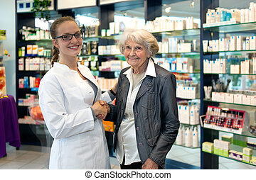Pharmacist assisting an elderly lady