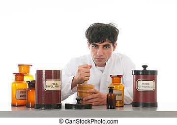 pharmacist at work - pharmacist working with many medicins