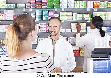 Pharmacist attending customer, show