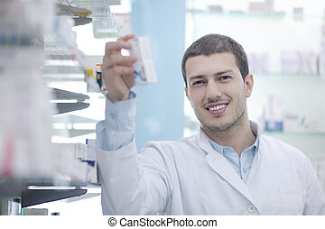 pharmacist chemist man in pharmacy drugstore
