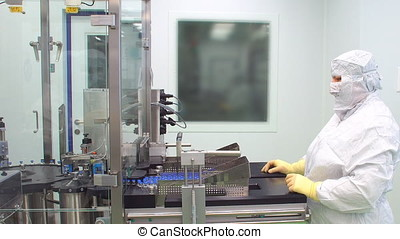 Pharmacist control pharmaceutical manufacturing process at drug factory. Pharmaceutical machine. Pharmaceutical worker check pharmaceutical production line.