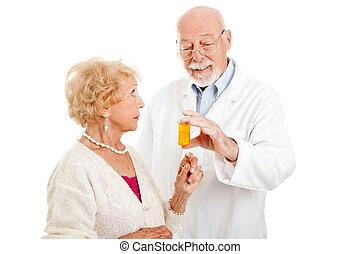 Pharmacist Giving Instructions - Pharmacist giving dosage...