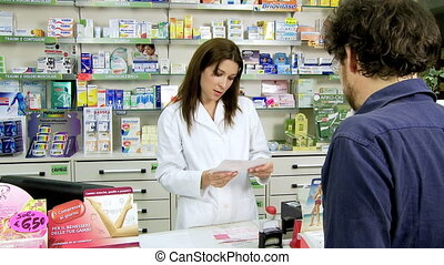 Pharmacist giving medicine to clien - Pharmacist in pharmacy...