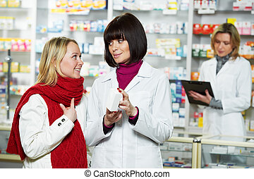 pharmacist helps to drug purchaser