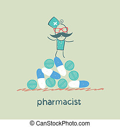 pharmacist is on a pile of pills and capsules