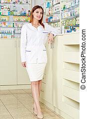 Pharmacist lady in the pharmacy