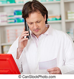 pharmacist looking serious while on call
