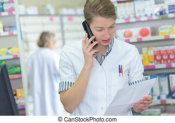pharmacist on the phone at the hospital pharmacy