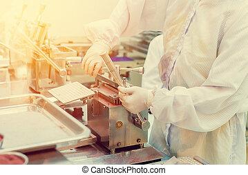 pharmacist preparing medication with packaging capsule in lab