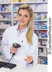 Pharmacist scanning medicines