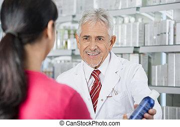Pharmacist Selling Deodorant To Woman