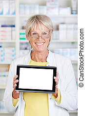 Pharmacist showing a tablet and smiling confidently