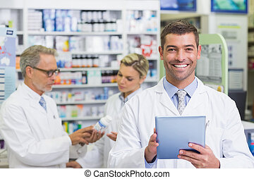 Pharmacist smiling at camera at the hospital pharmacy