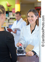 Pharmacist stamping paperwork