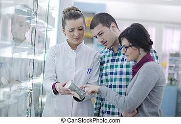 pharmacist suggesting medical drug to buyer in pharmacy...