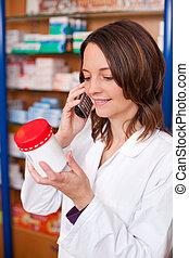 Pharmacist Talking On Phone