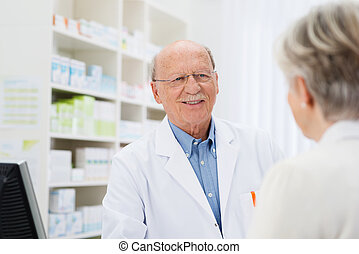 Pharmacist talking to a senior patient