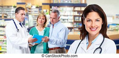 Pharmacist with a senior couple. - Pharmacist and a senior...
