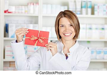 Pharmacist with card