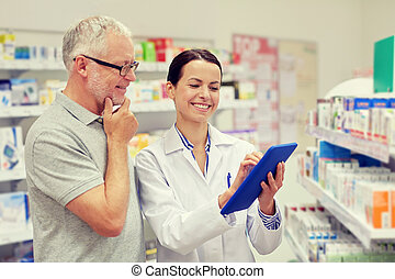pharmacist with tablet pc and senior man - medicine, ...