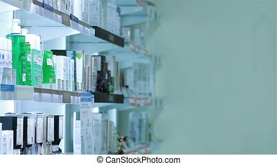 Pharmacist woman standing in pharmacy drugstore