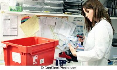 Pharmacist working in pharmarmacy - Woman pharmacist in...
