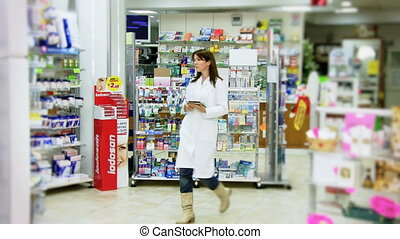 Pharmacist working with tablet