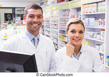 Pharmacists looking at camera - Team of pharmacists looking...